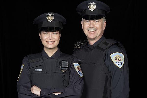 smiling law enforcement officers